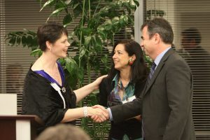 Ensemble member Dawn Bach presents the award/Photo: Johnny Knight